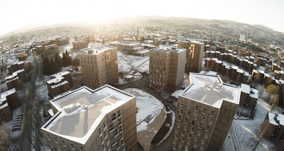 Aerial view of the Moholt 50/50 towers using CLT on a snowy day